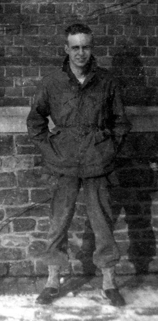 Photo of Private Tom Nix, 14th Chemical Maintenance Company, in his WW-II U.S. Army uniform, taken circa Winter of 1944-45 in Europe