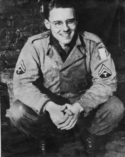 Photo of T/5 David O. Meeker Jr of the 14th Chemical Maintenance Company, in his WW-II U.S. Army uniform, taken January 1945, Ensival, Belgium