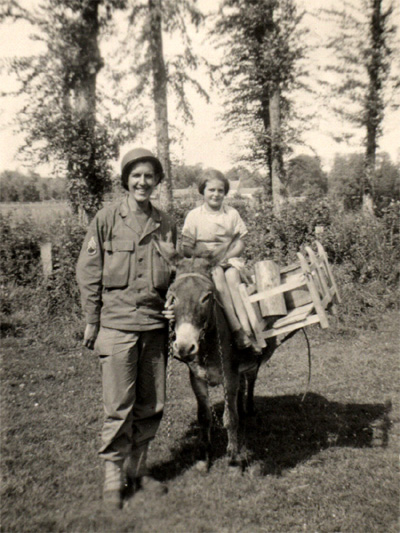 S/Sgt Herbert Landers, 14th Chemical Maintenance Company and young French girl on a donkey
