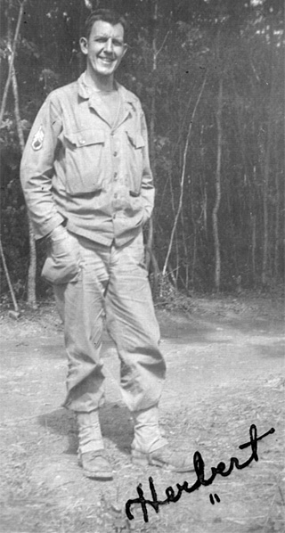 Photo of Staff Sergeant Herbert Landers, 14th Chemical Maintenance Company, in his WW-II U.S. Army uniform, taken circa 01 September 1944 near La Loupe, France