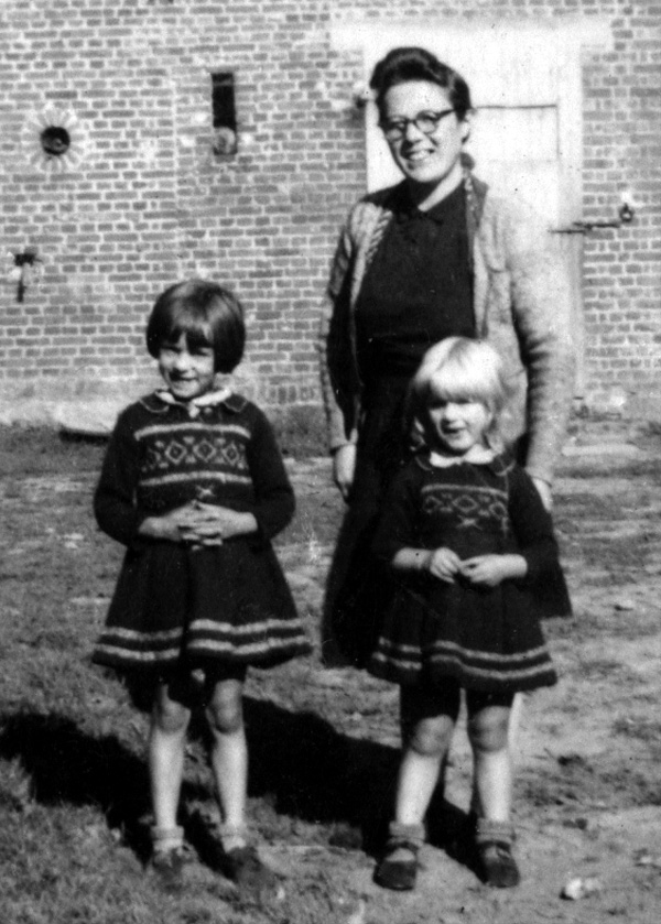 Photo of unidentified wife and children of caretaker of a chateau near Herve, Belgium used by 14th Chemical Maintenance Company, US Army, during late September and early October 1944