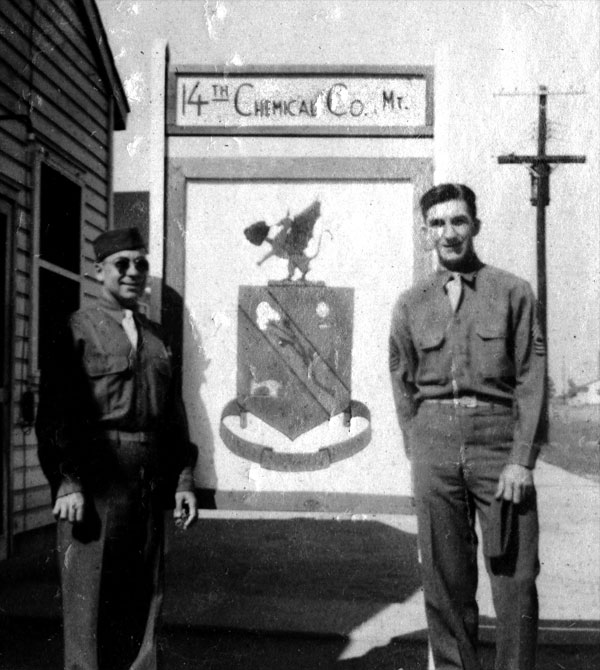 Photo of 14th Chemcial Maintenance Company crest and T/4 Harold Andrews and 1st/Sgt Edward Crawford, in their WW-II U.S. Army uniform, believed taken Camp Gordon, Georgia, 1943