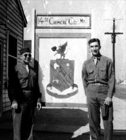 T/4 Harold Andrews and 1st/Sgt Edward Crawford in front of 14th company crest, Camp Gordon, Georgia, October-November 1943